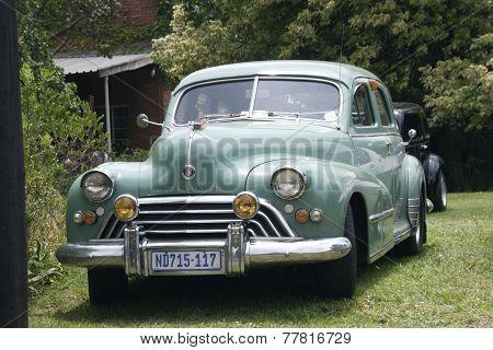 Green Vintage Oldsmobile Car Displayed At Show