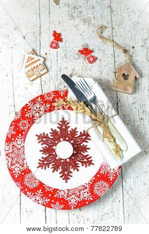 Christmas Decorations With Red Plate Cutlery And Toys