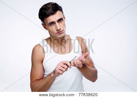 Man doing manicure and looking at the camera