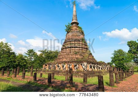 Ruins of Buddhist stupa or chedi in Sukhothai historical park in Wat Chang Lom. The old town was a capital of Sukhothai kingdom Thailand. poster