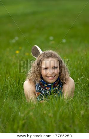 Young Girl Lay In The Grass