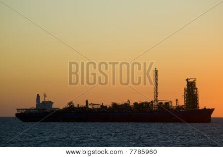 silhouette of an FPSO oil rig