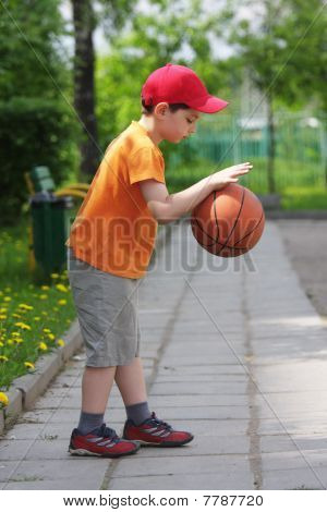 Little Boy Dribbling Basketball Sideview