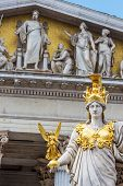 parliament in vienna, austria. seat of government. statue of pallas athena, goddess of weiheit. poster