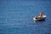 fisherman in a boat and two sea-gulls in the water poster
