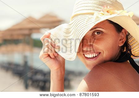Young woman on the beach in a sunny day