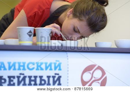 DNEPROPETROVSK, UKRAINE - MAY 31, 2013: Unidentified female competitor during 5th Ukrainian Cup Tasters Championship in Dnepropetrovsk, Ukraine on May 31, 2013