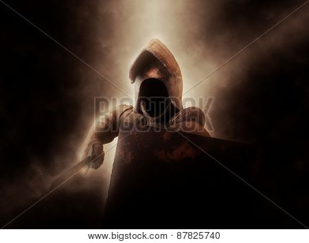 Dramatically Illuminated Faceless Knight in Suit of Armor with Shield and Sword