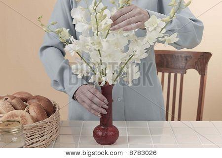 woman arranges flowers