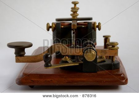 "an antique ""camelback"" morse key with its associated sounder on the same base - often this combination was known as a ""key on base"" or kob. this key dates from around 1860. the camelback morse key gains its name from the shape of the l poster"