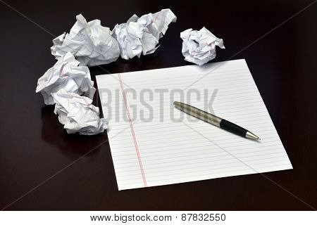 Ideas to be written down on blank sheet of paper crummpled sheets and pen