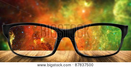 Clear stars in glasses on the background of blurred space. Elements of this image furnished by NASA