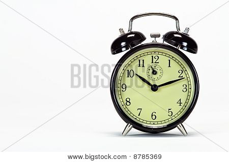 Black Alarm Clock Isolated On White With Text Space On Left