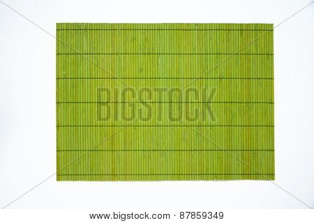 green bamboo place mat on white background