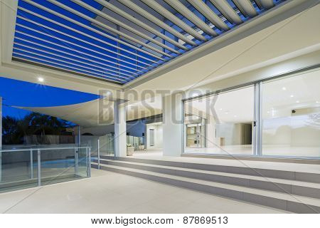White modern luxurious mansion exterior with deck and swimming pool on the Gold Coast Queensland Australia poster