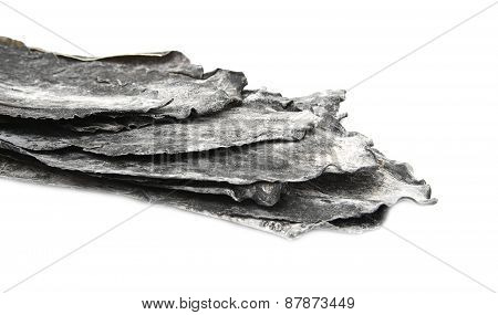 Dried leaves of brown seaweed Dashi Kombu   on white isolated poster