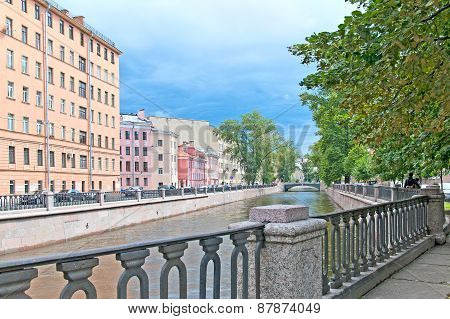 Saint-Petersburg. Russia. The Embankment of the Griboyedov Canal. On the background is Harlamov Bridge poster