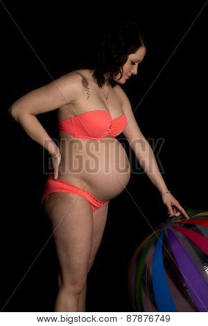 Pregnant Woman Bikini On Black Look At Ball