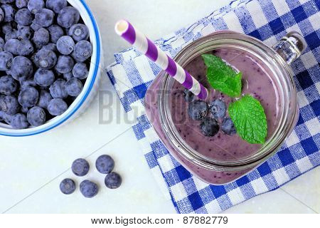 Blueberry smoothie in mason jar glass downward view