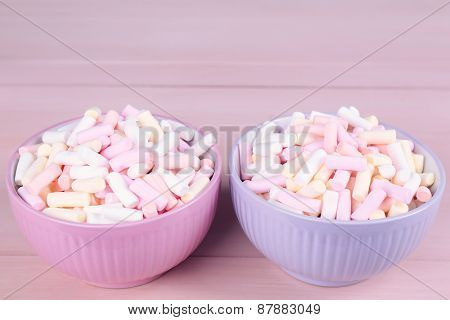 Sweet candies on color wooden background