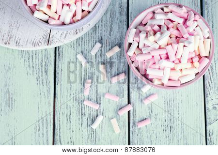 Sweet candies on wooden table, top view