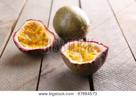 Passion fruits on wooden background poster