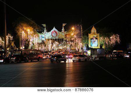 Bangkok Thailand - 5 December 2014: Ratchadamnoen main street is decorated to celebrate the 87th birthday of His Majesty King Bhumibol Adulyadej at the royal field Sanam Luang adjoining the Grand Palace Rattanakosin Central Bangkok