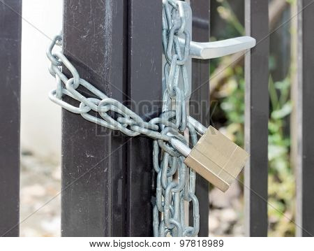door of a construction site closed by a padlock, protection against theft in a construction site