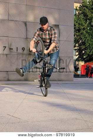 Rider showing tricks on a BMX bike at the Night of the Arts festival