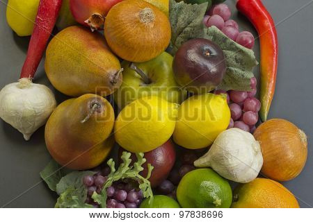 Assorted pile of different colorful fake fruits and vegetables poster