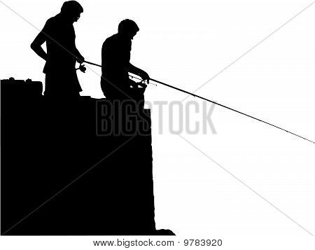 Silhouettes of fisherman in action