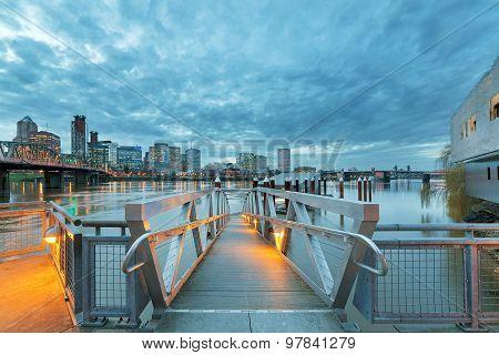 Portland Skyline Along Willamette River By The Pier