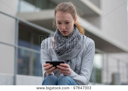 Shocked Woman Holding A Mobile Phone