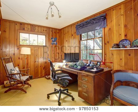 Traditional Home Office With Wood Panel Walls.