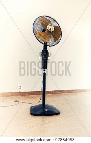 Large Modern Electric Fan In Empty Room