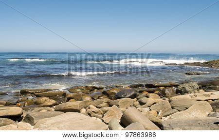 Ocean waves approach rocky shores