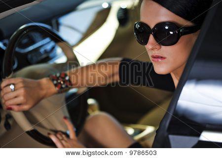 Sexy Woman In Luxury Car