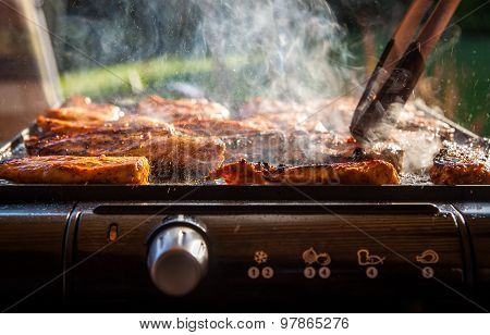 Tasty chicken steaks on the contact electric grill - closeup picture