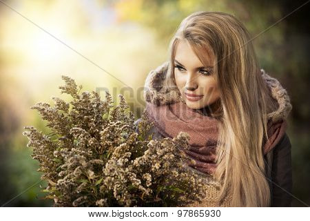 Young Girl Smiling In Autumn Scenery