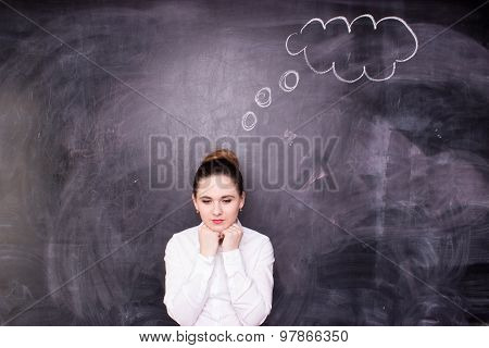 Woman thinking blackboard concept