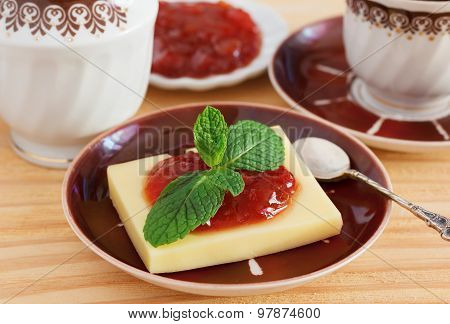 Brazilian dessert Romeo and Juliet goiabada jam and cheese with cup of coffee on wooden table. Selective focus poster