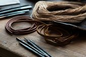 leather craft or leather goods making. work bench of a leather smith. Shallow depth of field. poster