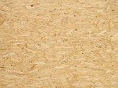 Pressed wooden panel background seamless texture of oriented strand board - OSB poster