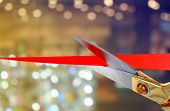 Scissors cutting red ribbon poster