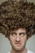 Scruffy faced man with messy curly hair afro poster