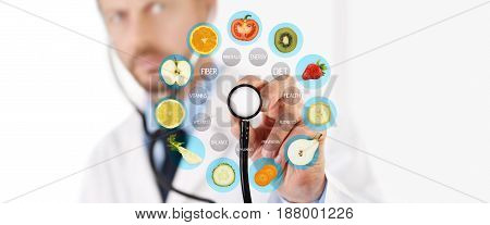 healthy food concept Hand of nutritionist doctor pointing fruit with stethoscope