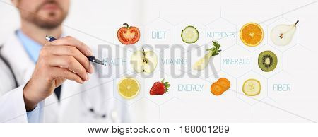 healthy food concept Hand of nutritionist doctor pointing fruit with pen