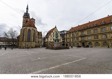 STUTTGART GERMANY - MARCH 01 2017: Schillerplatz - square in the old city named in honor of the German poet Friedrich Schiller. In the background Fruchtkasten building Prinzenbau building and Collegiate Church.
