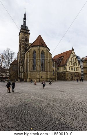 STUTTGART GERMANY - MARCH 01 2017: Schillerplatz - square in the old city named in honor of the German poet Friedrich Schiller. In the background Fruchtkasten building and Collegiate Church.