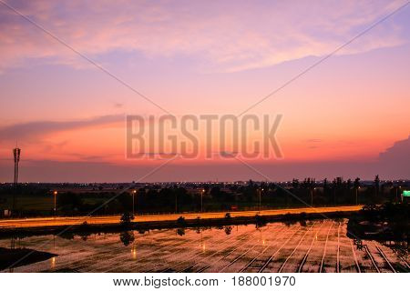 Landscape expressway and rice field with evening sky and reflect of water.